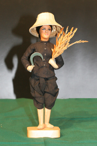 FARMER WOMAN (Carrying scythe and sheaf of paddy)